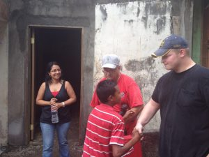 Young Manuel shaking hands and thanking Tim (left) and Steve (right). Our missions team host, Vilma, is also in the photo.