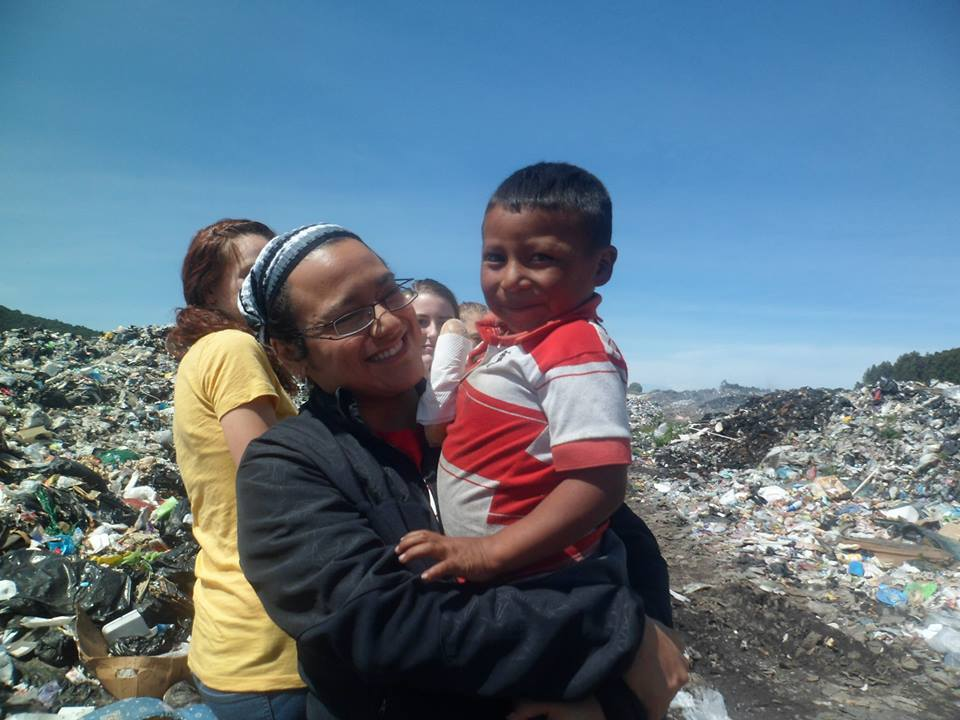 Gaby serving one of the precious children that she works with in her organization.